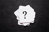 istock Sign of question cards on the black background. Solution search concept. 914039202
