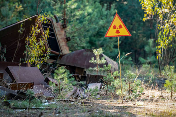 sign of radiation hazard on the background of radioactive garbage stock photo