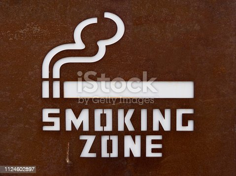 Close-up of designated smoking area sign. Sign of smoking zone. For peace of mind to separate the smokers from the non-smoking zone.