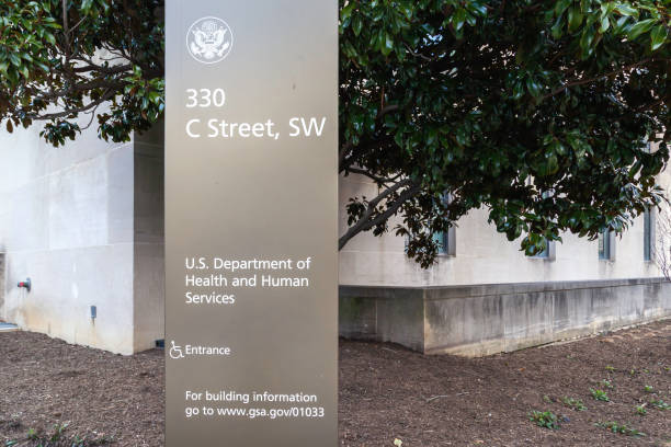 Sign of U.S. Department of Health & Human Services (HHS) at its headquarters building in Washington, D.C. USA. stock photo