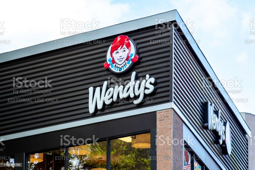 Sign of Wendy's restaurant in Niagara Falls, Ontario, Canada. Niagara Falls, Ontario, Canada - September 4, 2019: Sign of Wendy's restaurant in Niagara Falls, Ontario, Canada. Wendy's is an American international fast food restaurant chain. Burger Stock Photo
