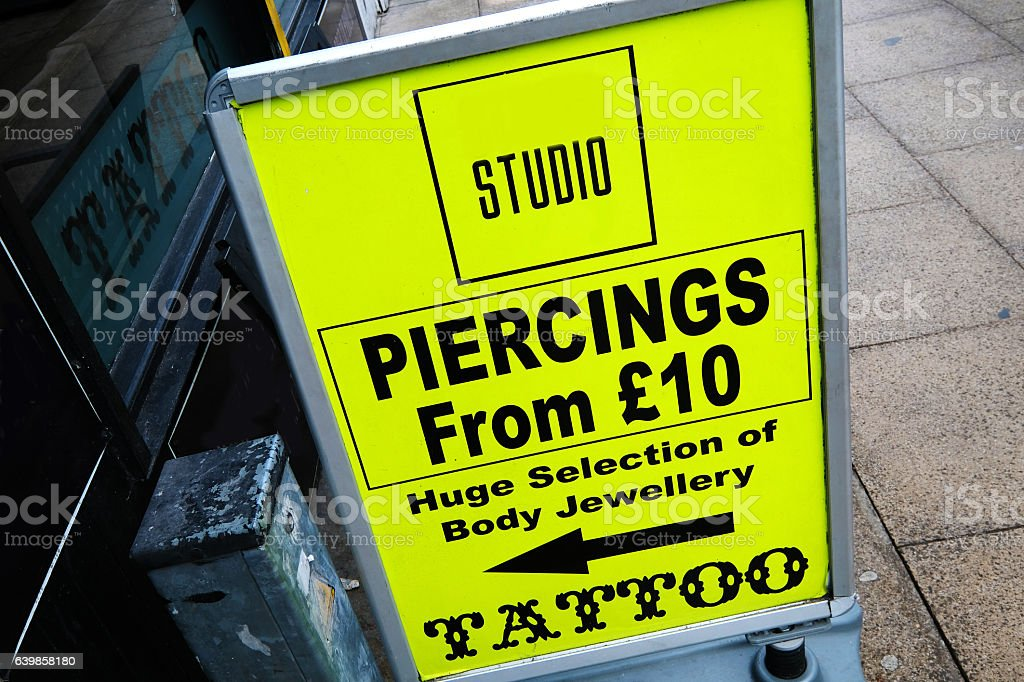 Sign Offering Body Art Stock Photo Download Image Now Istock