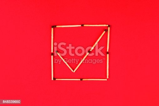 istock Sign ok in check boxes make of matches on red background 848339650