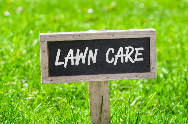 Sign on a green lawn - Lawn care Sign on a green lawn - Lawn care mowing stock pictures, royalty-free photos & images
