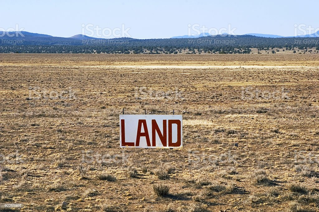 A sign on a large field that is for sale stock photo