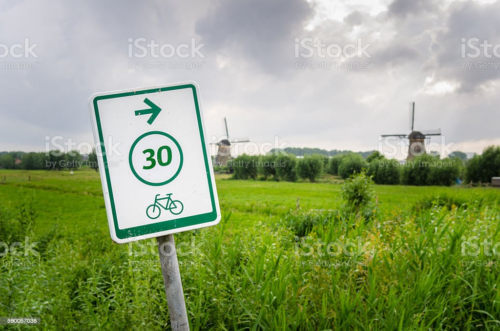 Sign on Bicycle path and Cloudy Sky - foto de acervo