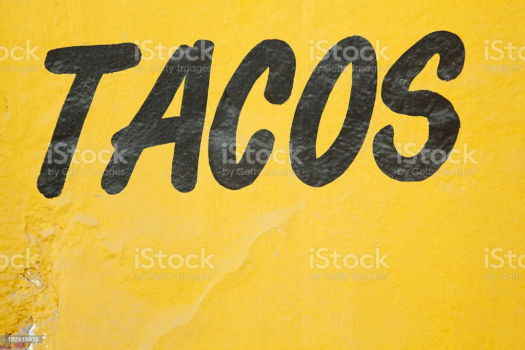 Sign on Bright Yellow Wall, Tacos, Food, Mexico stock photo
