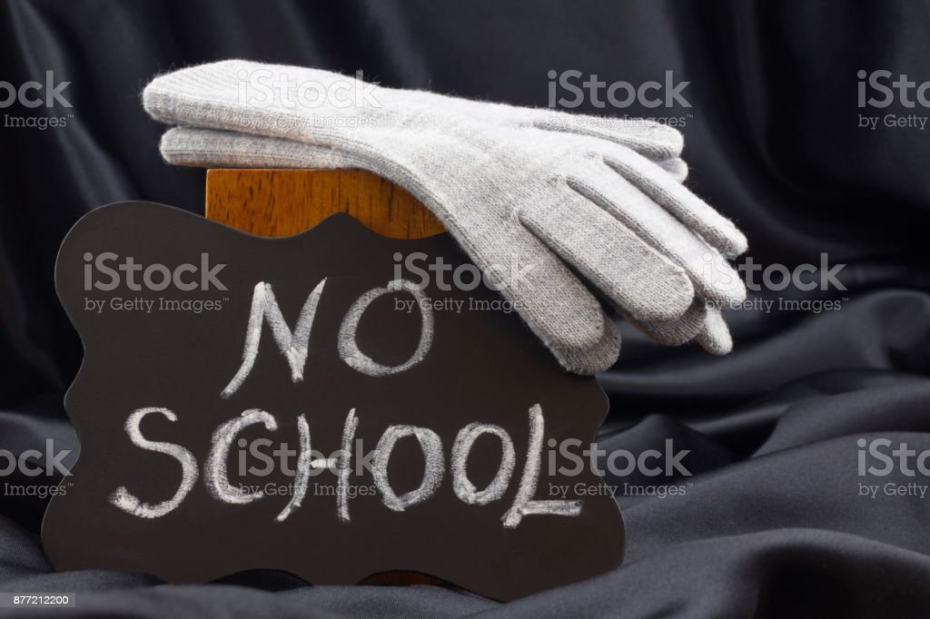 NO SCHOOL sign on chalkboard warns of cold weather closing stock photo