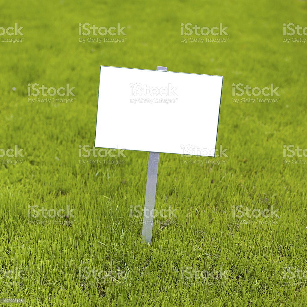 Sign on grass stock photo