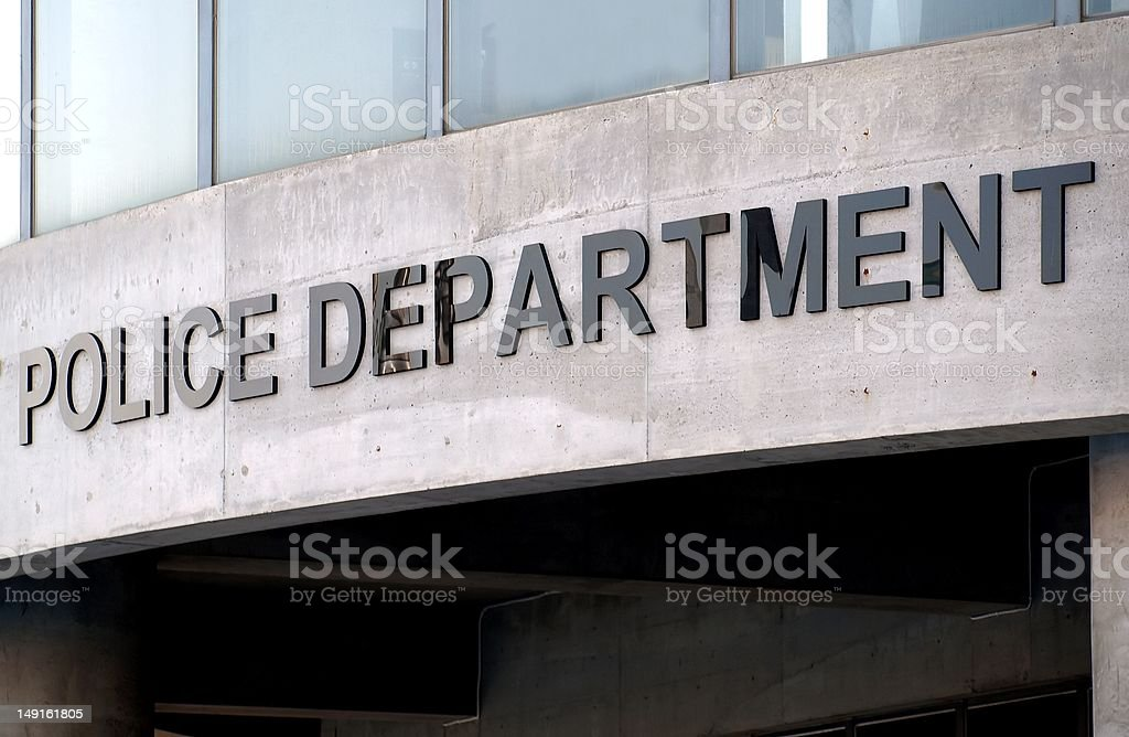 Sign on Police Building stock photo