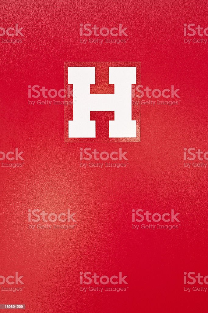 H - sign on street hydrant royalty-free stock photo