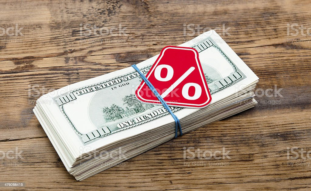 Sign % on the background of one hundred dollar bills stock photo