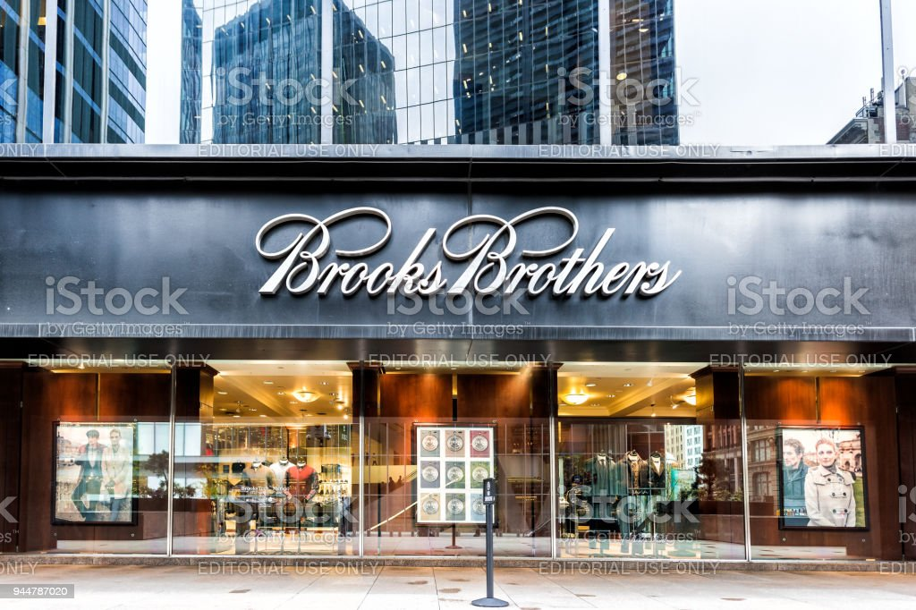 Sign on the building of Brooks Brothers business clothing store in...