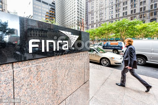istock Sign on the building of Financial Industry Regulatory Authority, or Finra, in Manhattan NYC lower financial district downtown, businessman man walking 944778530