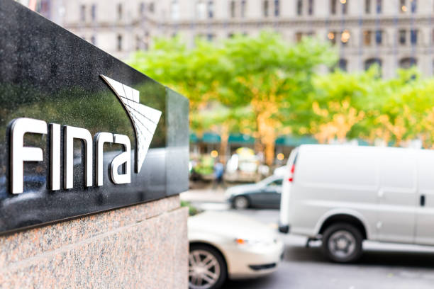 sign on the building of financial industry regulatory authority, or finra, in manhattan nyc lower financial district downtown - exchange rate stock pictures, royalty-free photos & images