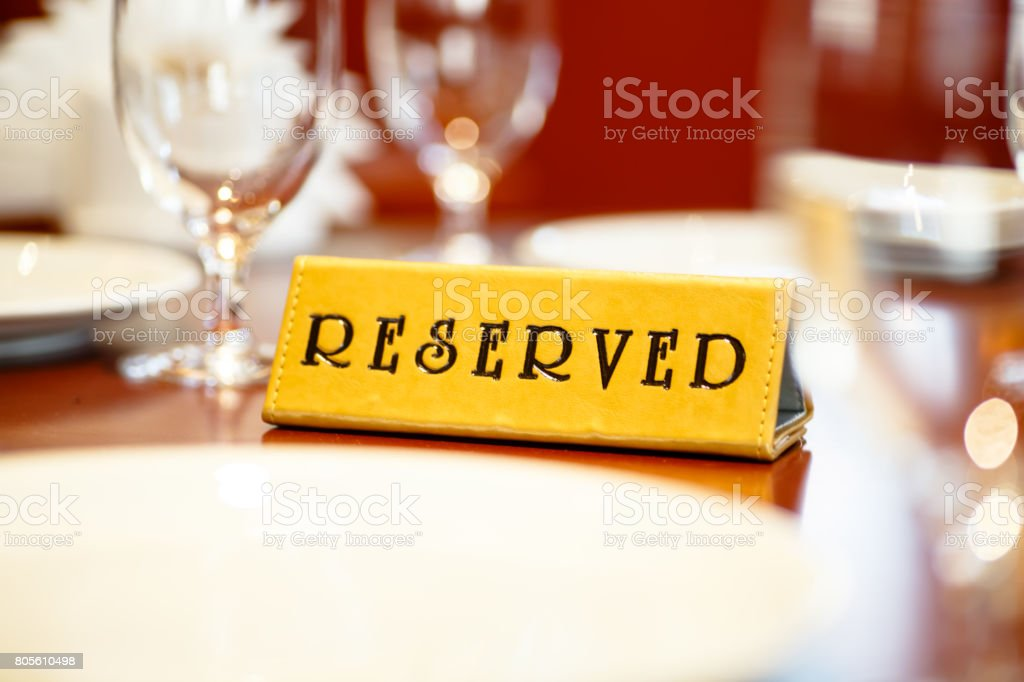 A sign on the reserved table in the restaurant. stock photo