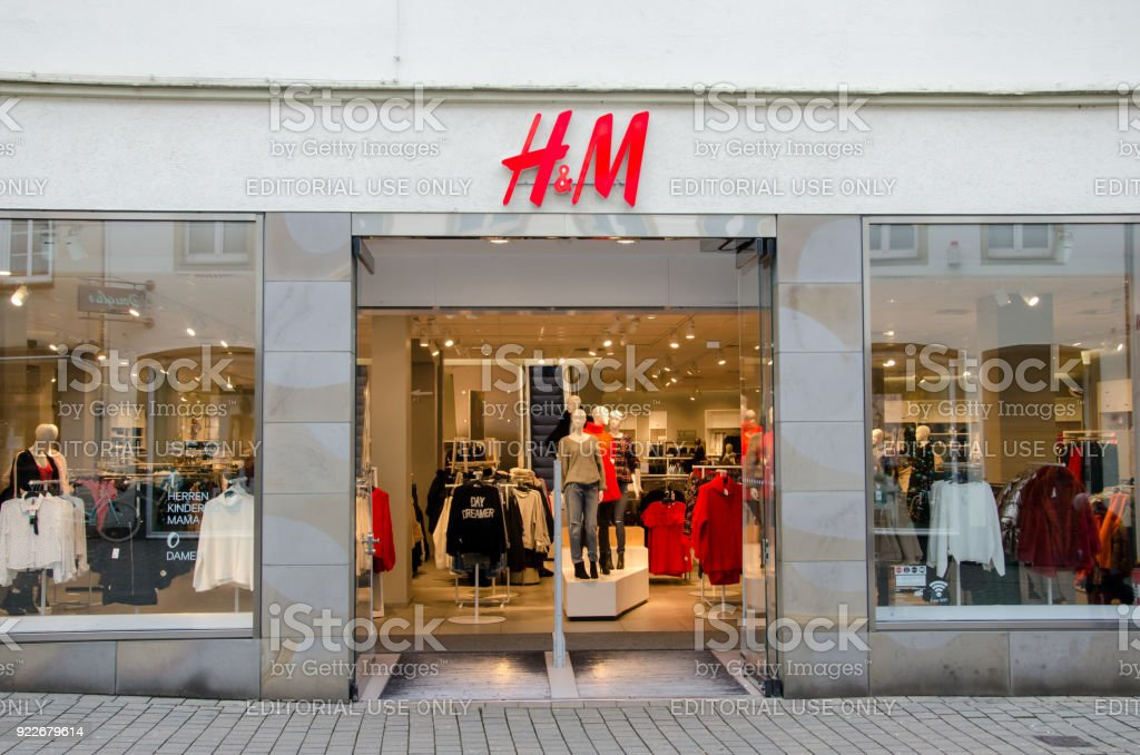 H&M sign on the wall. H&M Hennes & Mauritz AB is a Swedish multinational clothing-retail company, clothing for men, women, teenagers and children. stock photo
