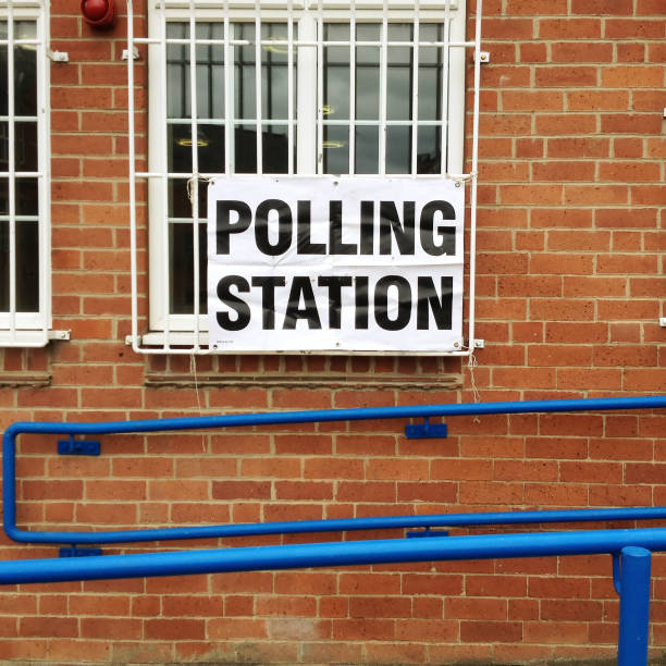sign on the wall of a polling station in uk - polling place stock pictures, royalty-free photos & images