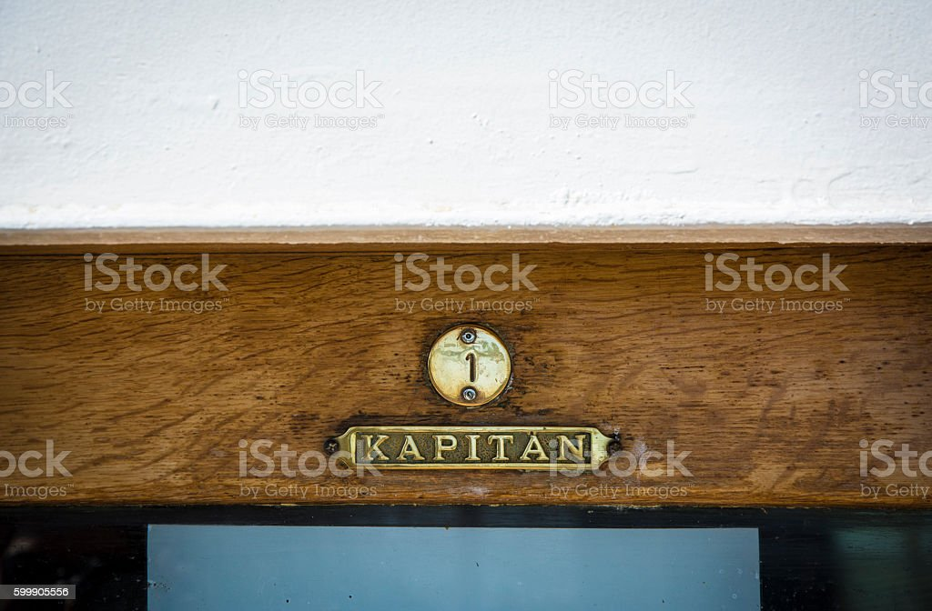 Sign on top of the captain's cabin stock photo