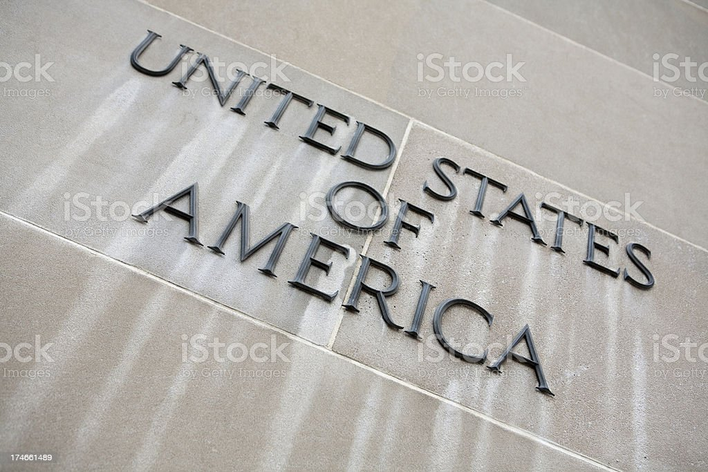 Sign on wall stating United States of America royalty-free stock photo