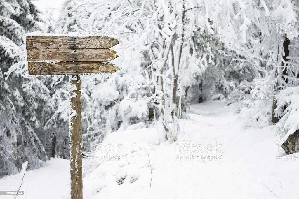 sign on winter trail stock photo
