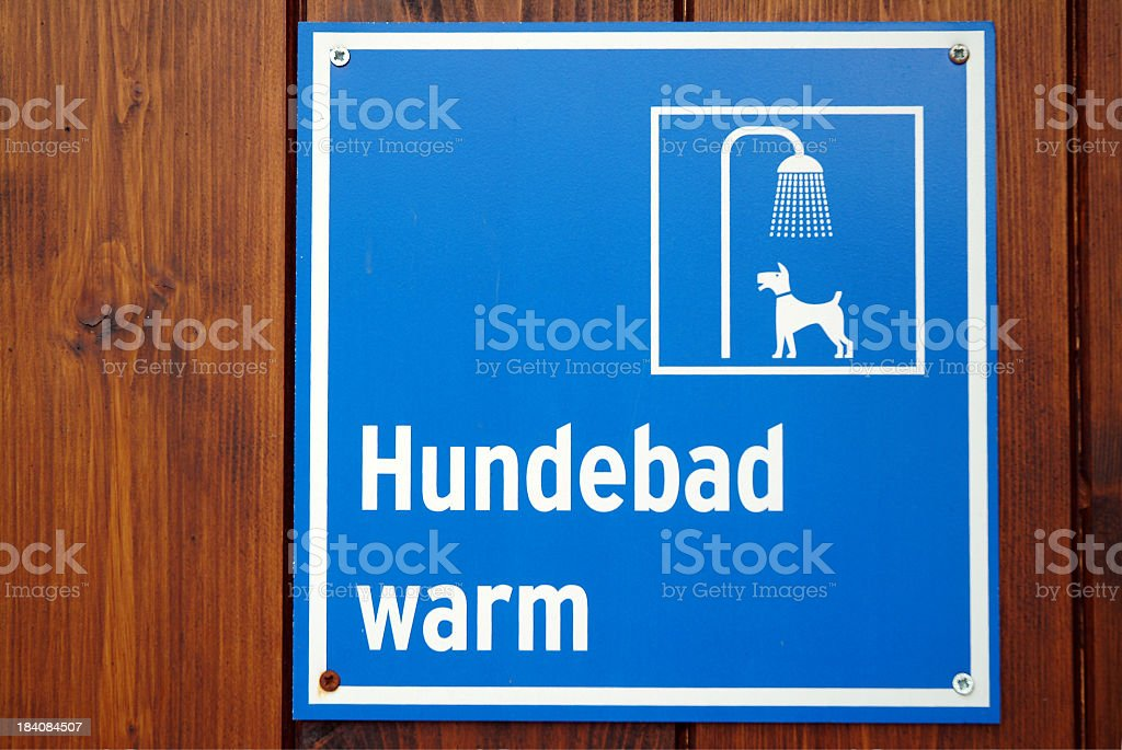 Sign on wooden wall indicating dog shower royalty-free stock photo
