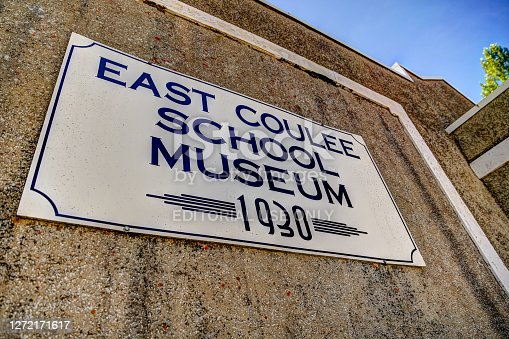 East Coulee, Alberta, Canada - July 3, 2020: Outdoor sign for the East Coulee School Museum in East Coulee Alberta, a formerly robust town during the coal mining years of the early to mid 1900's.