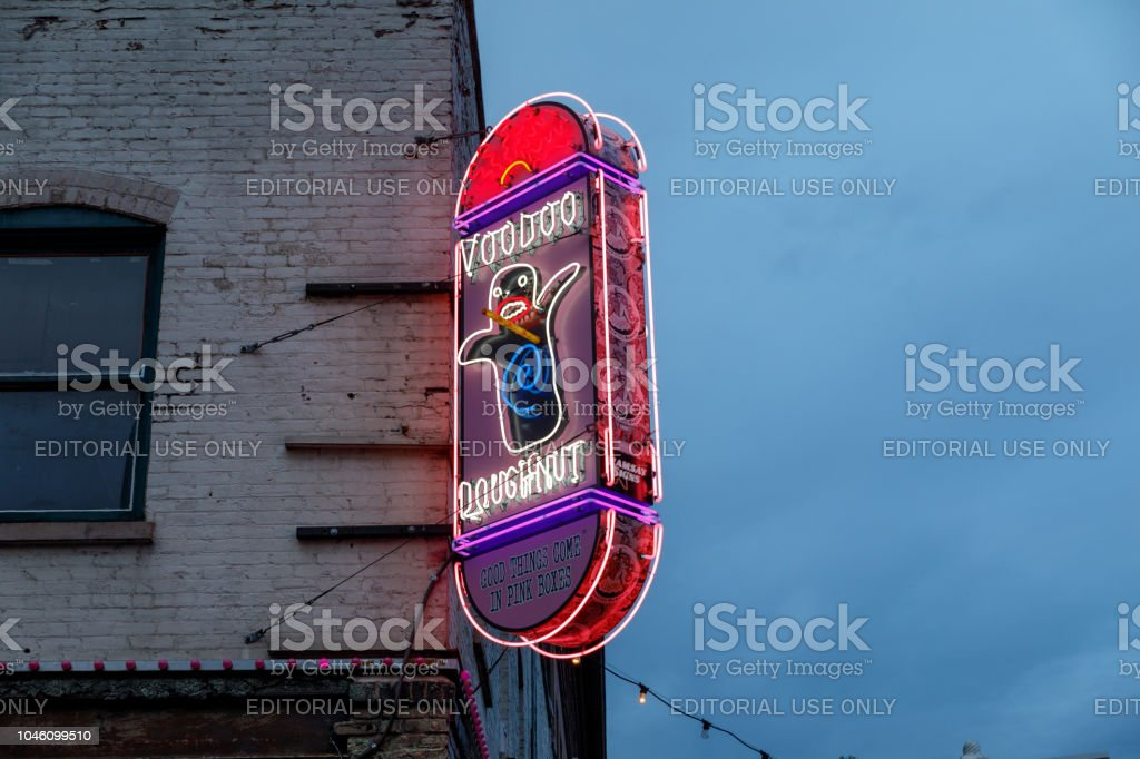 Sign outside of the original Voodoo Doughnuts on 3rd Avenue in downtown Portland Portland, Oregon - Sep 16, 2018 : Sign outside of the original Voodoo Doughnuts on 3rd Avenue in downtown Portland Architecture Stock Photo