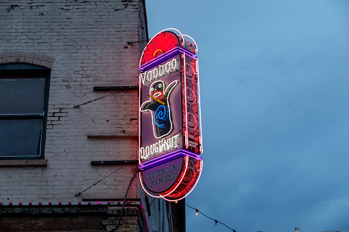 Sign Outside Of The Original Voodoo Doughnuts On 3rd Avenue In Downtown Portland Stock Photo - Download Image Now