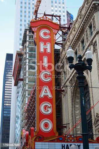 Chicago, Illinois, USA - June 21, 2008, The large electric sign, the Chicago Theatre, opened in 1921, is an iconic State Street landmark in downtown Chicago.