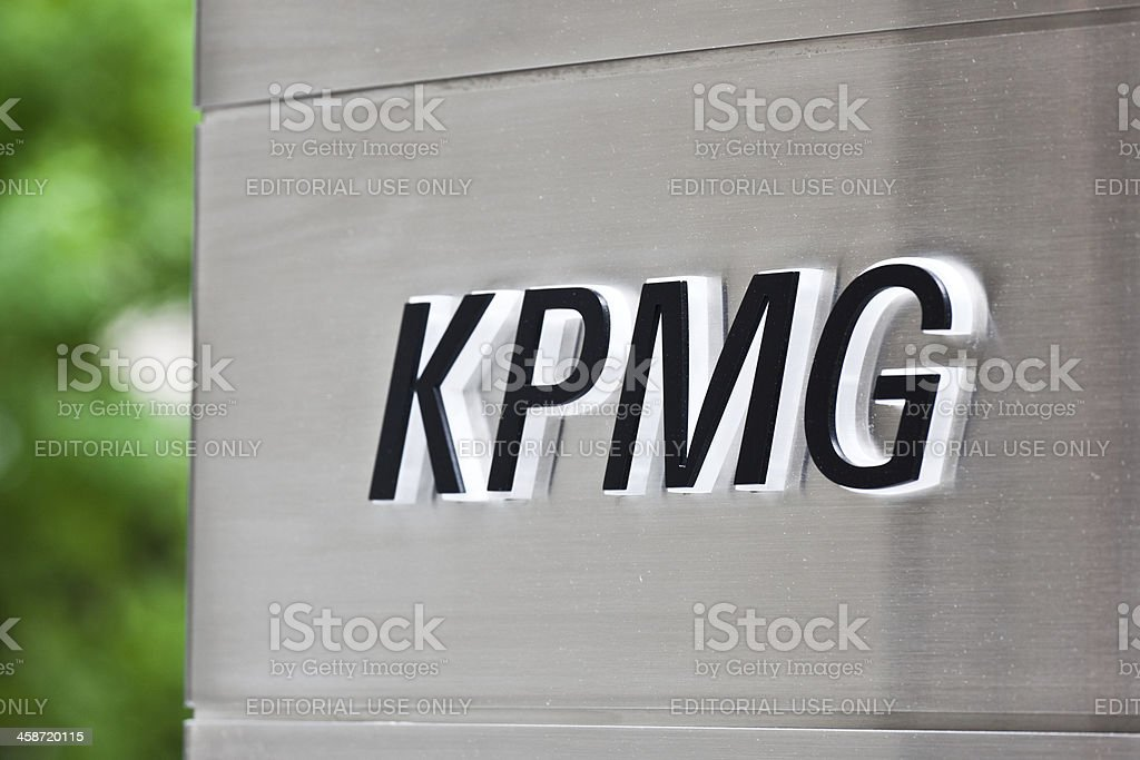 KPMG sign Houston, Texas, USA - April 4, 2011: close-up of a KPMG sign located on a building in Houston Downtown. KPMG is one of the largest professional services firms in the world. Its global headquarters is located in the Netherlands. Close-up Stock Photo