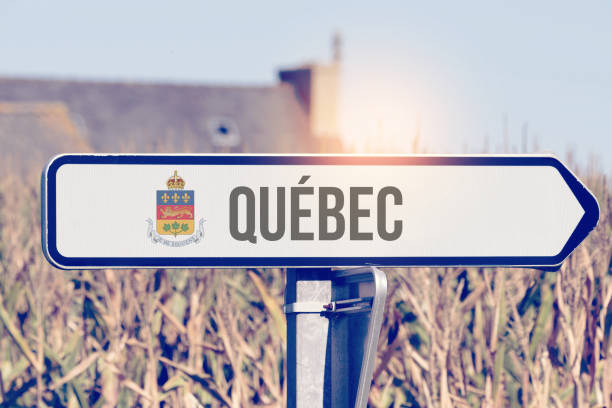 A sign points toward Quebec in Canada stock photo
