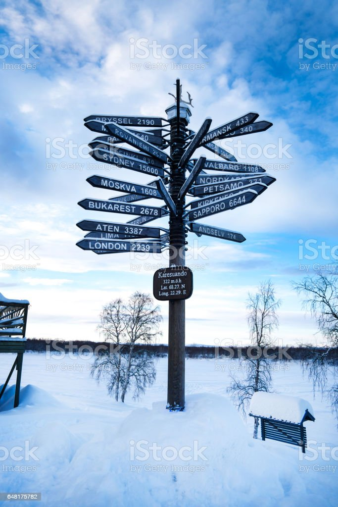 sign post pointing to over 20 cities worldwide stock photo