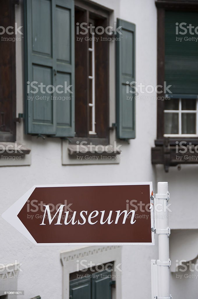 Sign post to the museum stock photo