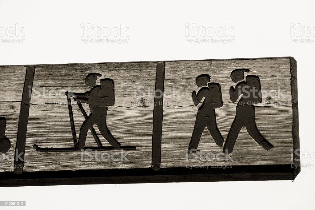 sign post with people walking and skiing in cross country stock photo