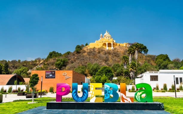 Sign Puebla and the Church of Our Lady of Remedies, Mexico stock photo
