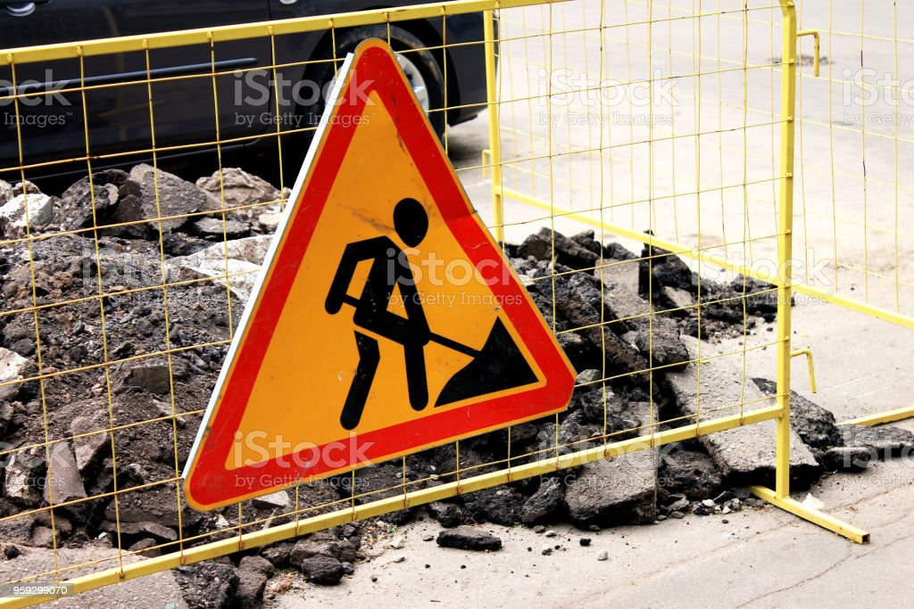 Sign road construction, road maintenance in the city street stock photo
