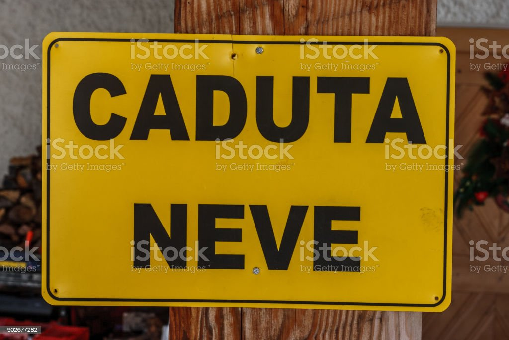 Sign saying 'Caduta Neve' (beware of the falling snow),  Cortina D'Ampezzo, Italy stock photo