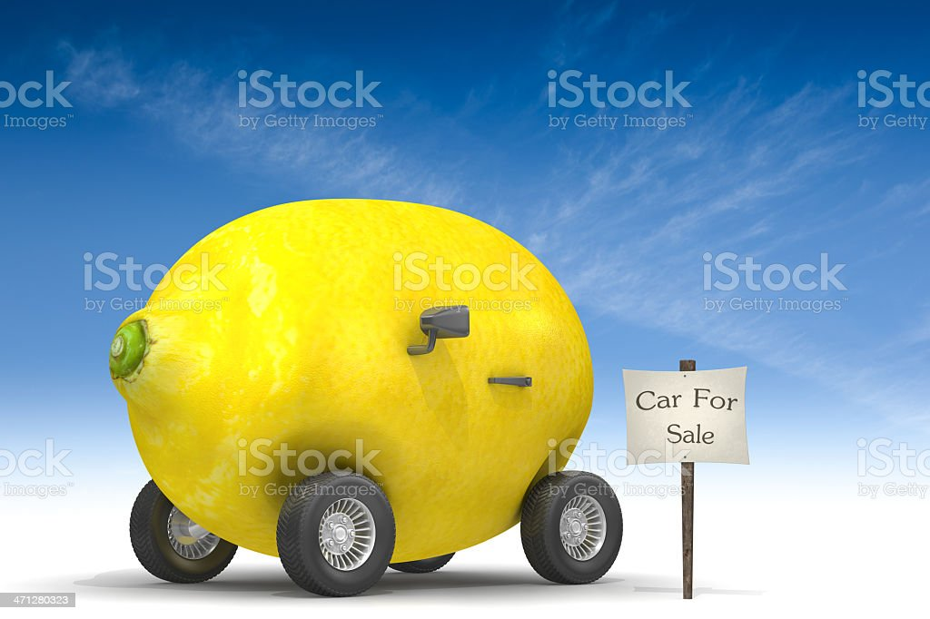 A sign saying car for sale next to a lemon with wheels royalty-free stock photo