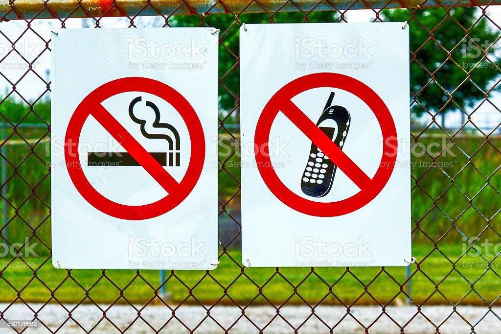 Sign saying no Phones and No cigarettes stock photo