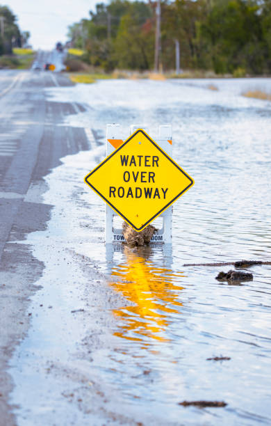 Sign saying water over roadway is very accurate. stock photo