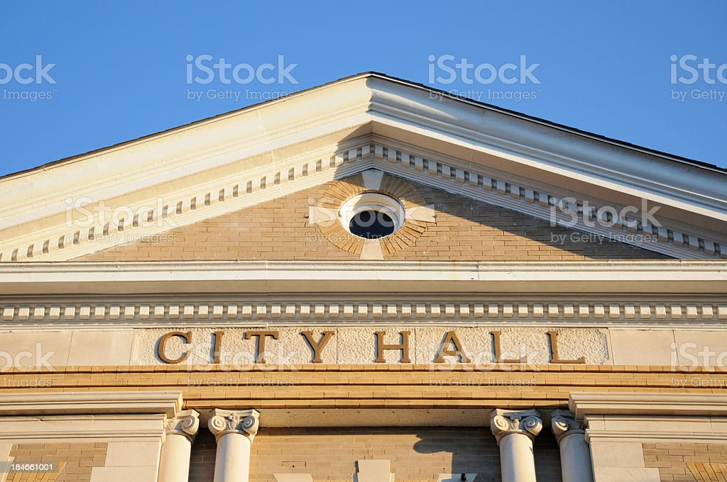 A sign showing city hall on a building  stock photo