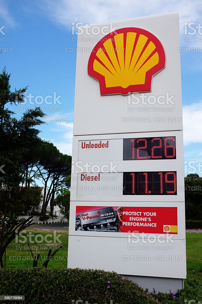 Sign Showing Current Fuel Prices At Shell Gas Station Stock Photo