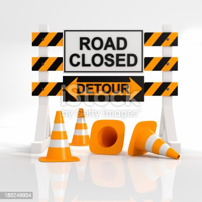 istock A sign showing that a road is closed with a detour sign 185249934