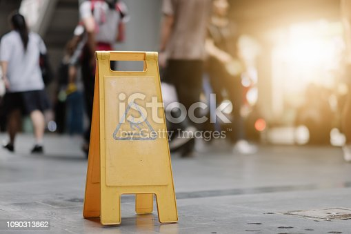 istock Sign showing warning of caution wet floor whitin airport. 1090313862