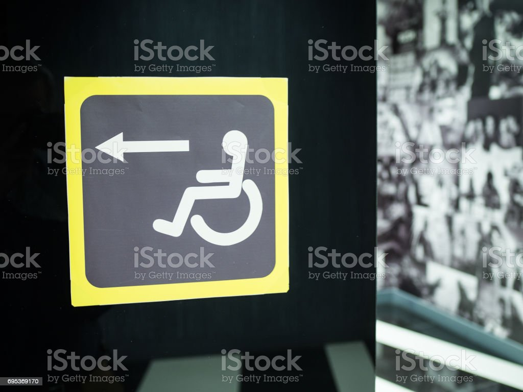 Sign sign for disabled on a black background stock photo