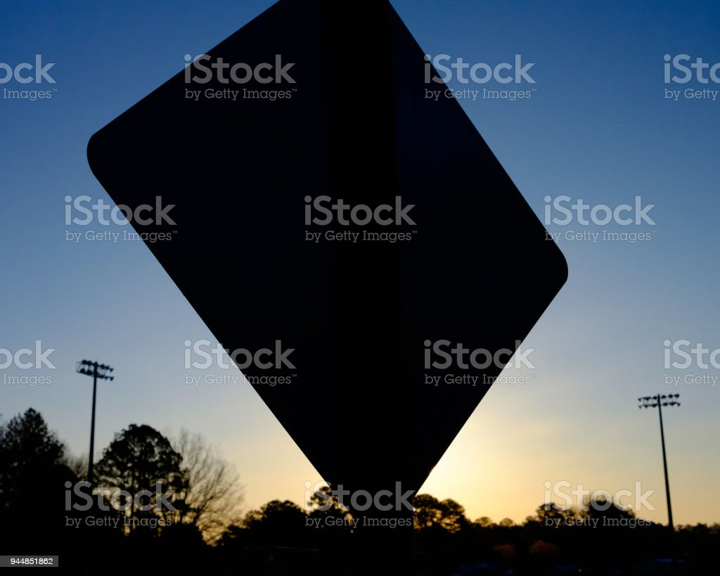 Sign Silhouettte at Sunrise stock photo