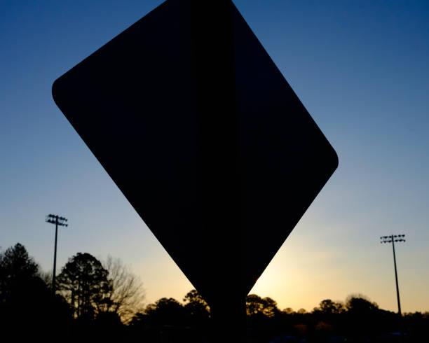 Sign Silhouettte at Sunrise stock photo