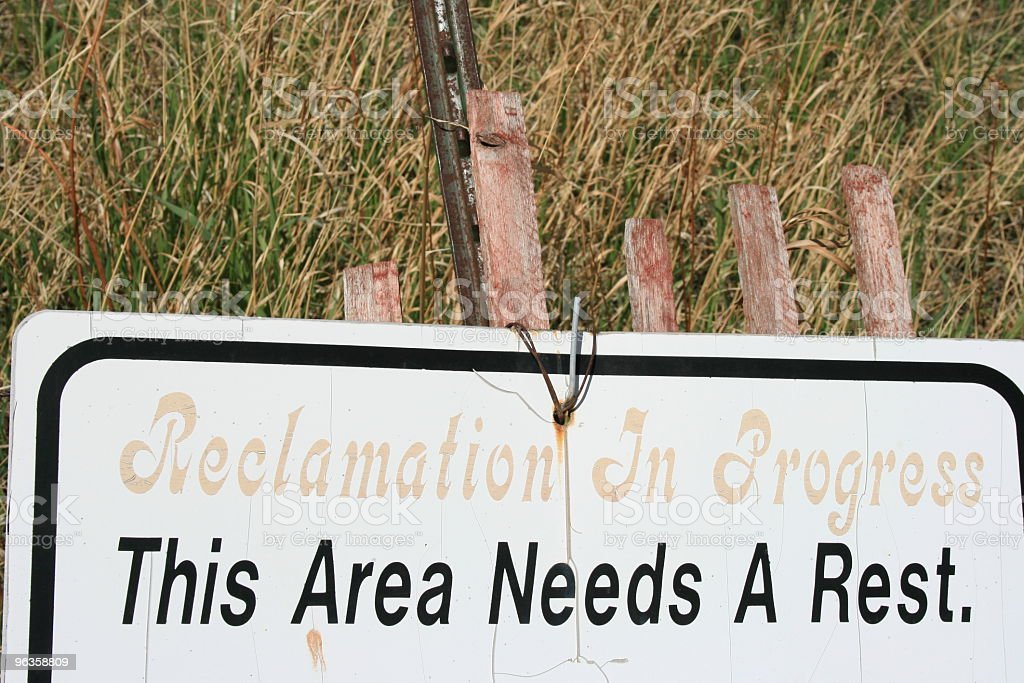 sign stating  'This area needs a rest' stock photo