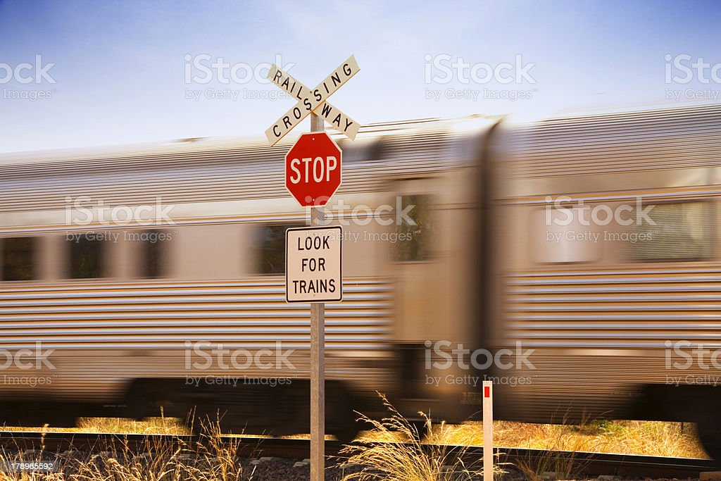 Sign Stop Look for Trains with a Train Just Passing royalty-free stock photo